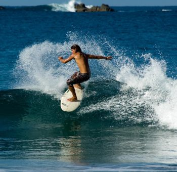 Surfer Riding the Waves in Costa Rica