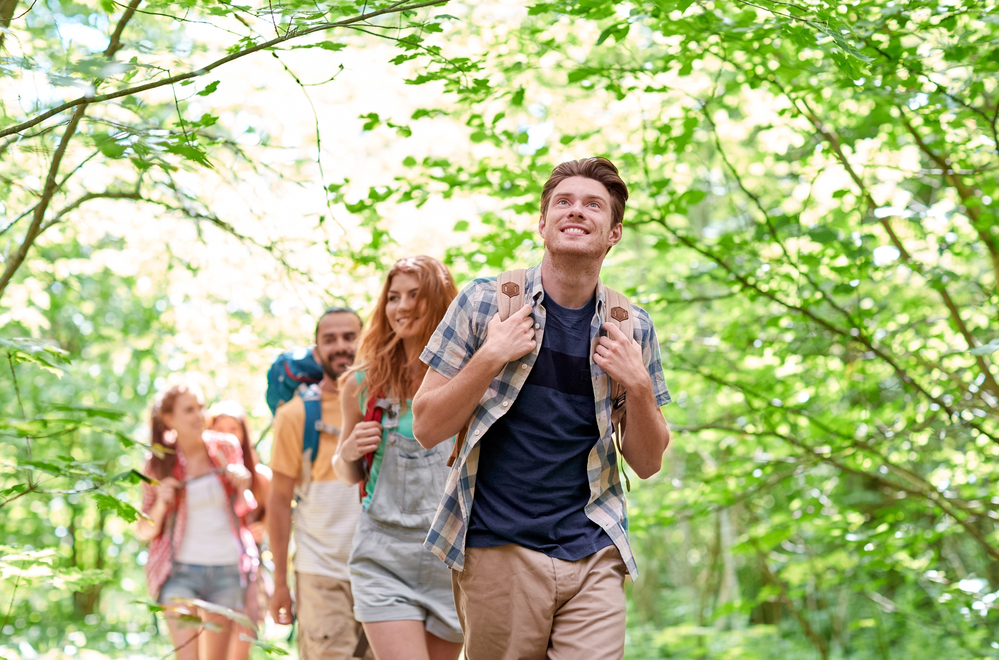 group of smiling people hiking through a Costa Rica forest