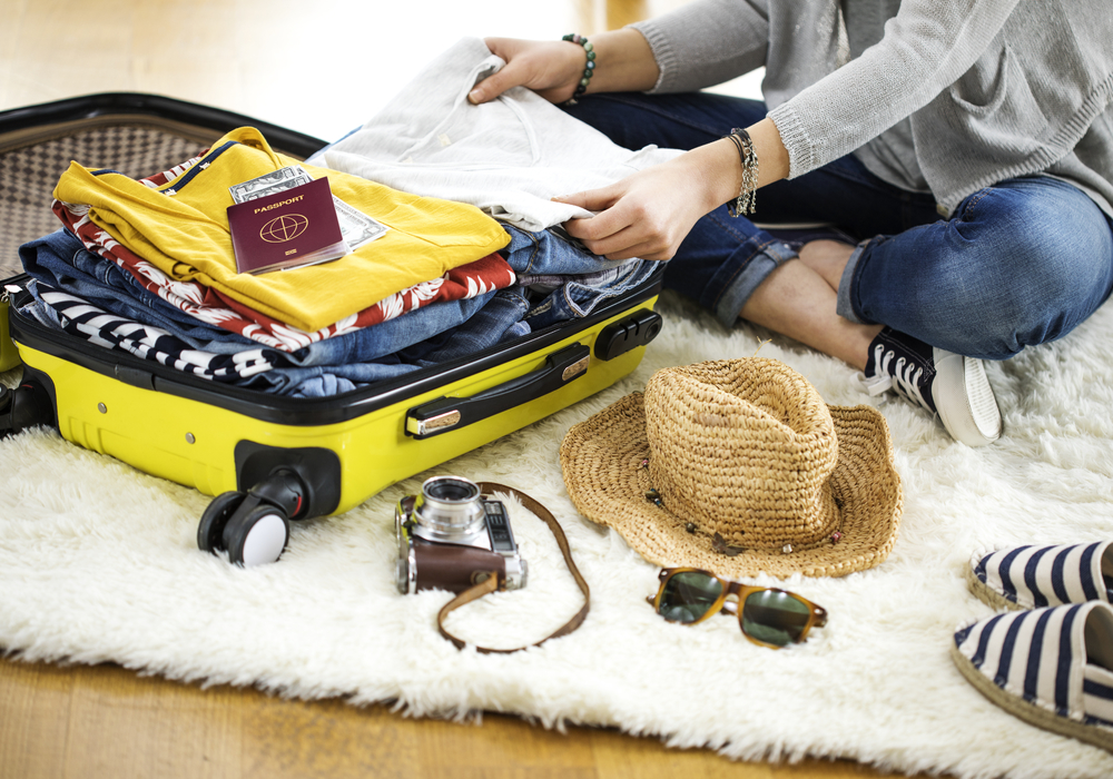 woman packing for Costa Rica vacation